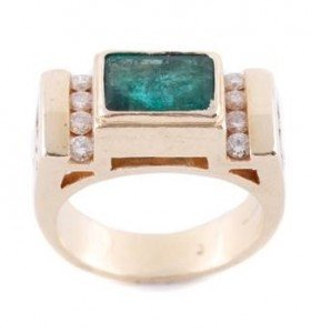 A ladies 14k yellow gold, diamond, and enhanced emerald ring
