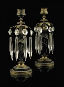 patinated bronze figural candlesticks