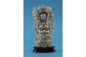 elaborately carved standing deity