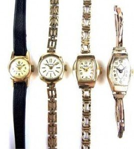 four gold ladies watches