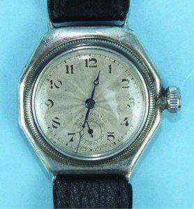 silver-cased wrist watch