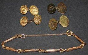 gold oval cufflinks