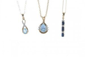 three gem-set pendants