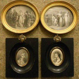 white prints in oval gilt frames