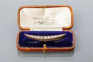 crescent brooch