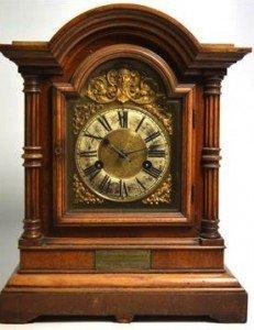 striking walnut cased mantel clock