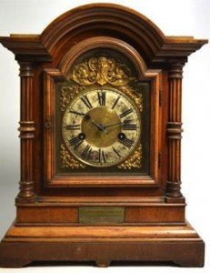 walnut cased mantel clock