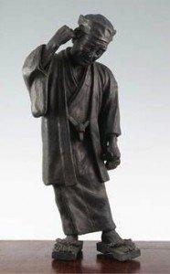 bronze figure of an old man