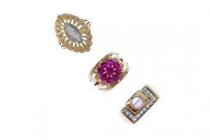 three gem-set dress rings