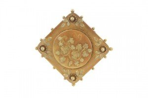 foliate panel brooch