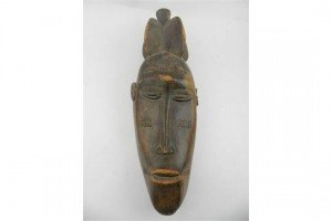 carved palm wood mask