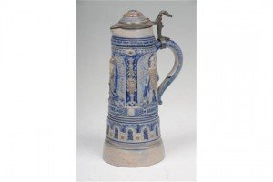 stoneware and pewter lidded jug