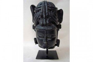 antique carved stone head