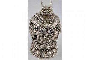 white metal incense burner