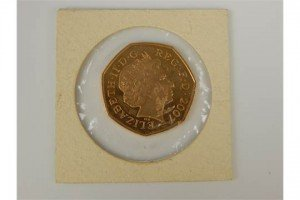 gold 50 pence coin
