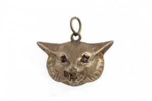 gold pendant of a fox head