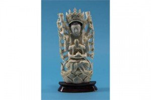 elaborately carved standing deity